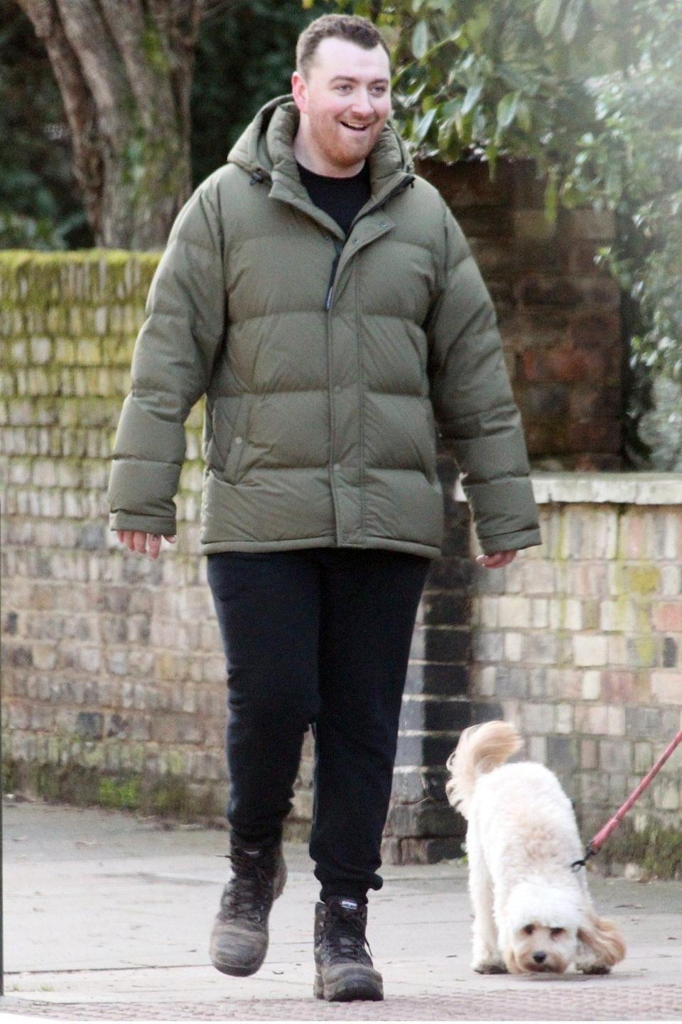 <p>Sam Smith and his puppy get some fresh air while on a walk through Hampstead, London on Thursday.</p>