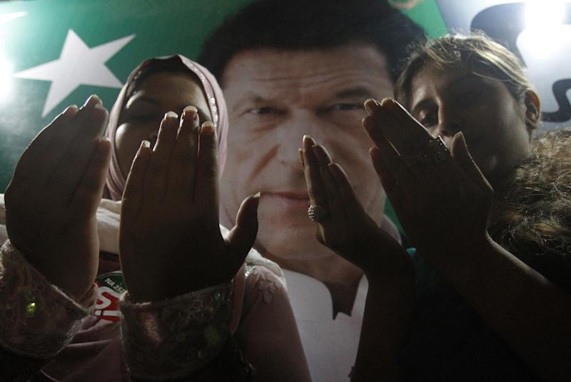 Supporters of Pakistan's cricket star-turned-politician Imran Khan pray for their leader's health in Karachi, Pakistan on Tuesday, May 7, 2013. One of Pakistan's most prominent politicians, Khan, fell from a stage at a political rally Tuesday in Lahore, leaving him with two hairline skull fractures and uncertainty hanging over his ability to campaign ahead of Saturday's general election. (AP Photo/Shakil Adil)