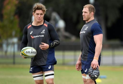 Australian Wallabies' captain Michael Hooper (L) chats with teammate David Pocock during a training session in Melbourne on June 12, 2018, ahead of their second Test match against Ireland