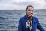 Denmark's Prime Minister Mette Frederiksen views Middelgrund's wind turbines near Copenhagen, Thursday April 22, 2021. President Joe Biden will open a global climate summit, an all-virtual climate summit for 40 world leaders, on Thursday, with a pledge to cut at least in half the climate-wrecking coal and petroleum fumes that the U.S. pumps out. (Emil Helms/Ritzau Scanpix via AP)