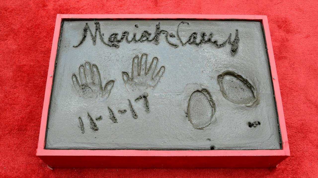 Mariah Carey Achieves Her 'Childhood Dream' At Hand and Footprint Ceremony (hand and footprints on cement)