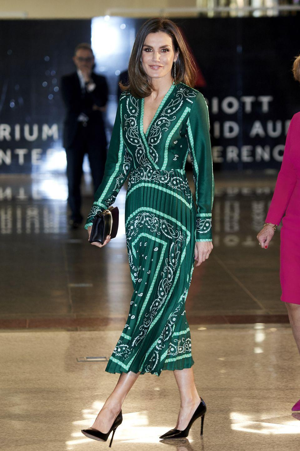 <p>The Queen looked incredibly chic in an emerald, paisley dress and black pumps. </p>