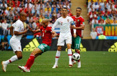 Soccer Football - World Cup - Group B - Portugal vs Morocco - Luzhniki Stadium, Moscow, Russia - June 20, 2018 Portugal's Joao Mario in action with Morocco's Karim El Ahmadi as Portugal's Cristiano Ronaldo and Morocco's Nabil Dirar look on REUTERS/Kai Pfaffenbach