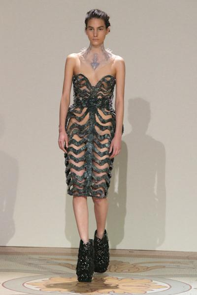 A model wears a creation by Dutch designer Iris van Herpen for the Haute Couture Fall-Winter 2013-2014 collection, Monday, July 1, 2013 in Paris. (AP Photo/Michel Euler)