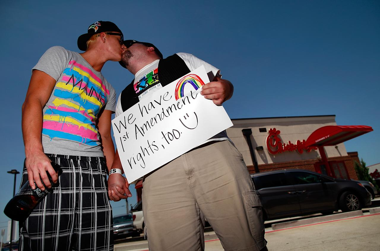 Same sex couple Tyler Savage and Larry Farris kiss outside a Chick-fil-A restaurant on August 3, 2012 in Dallas, Texas. Several couples gathered to kiss in support of a National Same Sex Kiss Day at Chick-fil-A held across the country in response to Chick-fil-A's stance on gay marriage. (Photo by Tom Pennington/Getty Images)