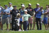 Rory McIlroy, of Northern Ireland, center, hits from the rough on the fifth hole during the second round of the BMW Championship golf tournament, Friday, Aug. 27, 2021, at Caves Valley Golf Club in Owings Mills, Md. (AP Photo/Nick Wass)