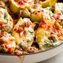 """<p>Mini turkey meatballs take these meaty shells to the next level.</p><p>Get the <a href=""""https://www.delish.com/uk/cooking/recipes/a28829264/spinach-stuffed-shells-with-mini-turkey-meatballs-recipe/"""" rel=""""nofollow noopener"""" target=""""_blank"""" data-ylk=""""slk:Spinach Stuffed Shells with Mini Turkey Meatballs"""" class=""""link rapid-noclick-resp"""">Spinach Stuffed Shells with Mini Turkey Meatballs</a> recipe.</p>"""