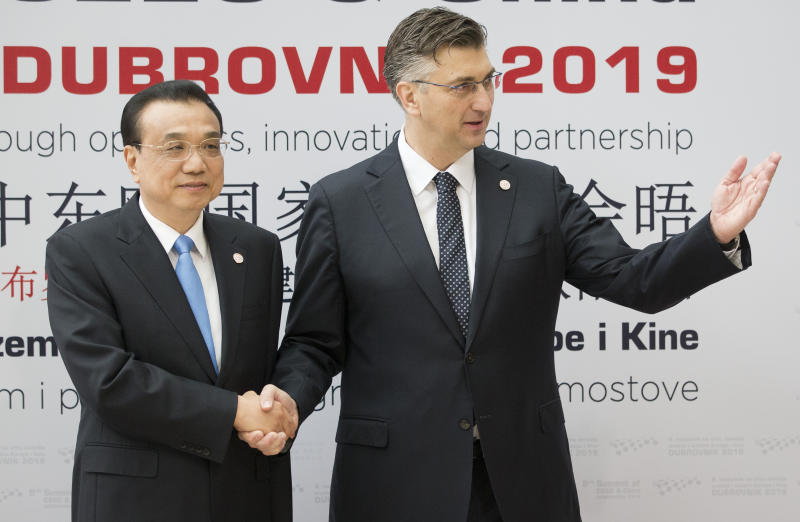 Croatia's Prime Minister Andrej Plenkovic, right, welcomes his Chinese counterpart Li Keqiang at the Summit of Central and Eastern Europe and China in Dubrovnik, Croatia, Friday, April 12, 2019. EU member Croatia is hosting a two-day summit between China and 16 regional countries on expanding business between China and the region, which is dubbed 16+1. (AP Photo/Darko Bandic)