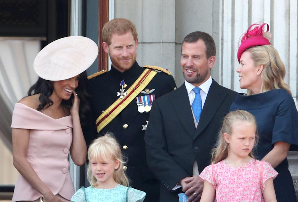 (Left to right) Duchess and Duke of Sussex with Peter and Autumn Phillips and daughters Isla and Savannah on the balcony of Buckingham Palace, in central London, following the Trooping the Colour ceremony at Horse Guards Parade, as Queen Elizabeth II celebrates her official birthday.
