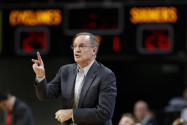 Oklahoma head coach Lon Kruger directs his team during the first half of an NCAA college basketball game against Iowa State, Monday, Feb. 25, 2019, in Ames, Iowa. (AP Photo/Charlie Neibergall)