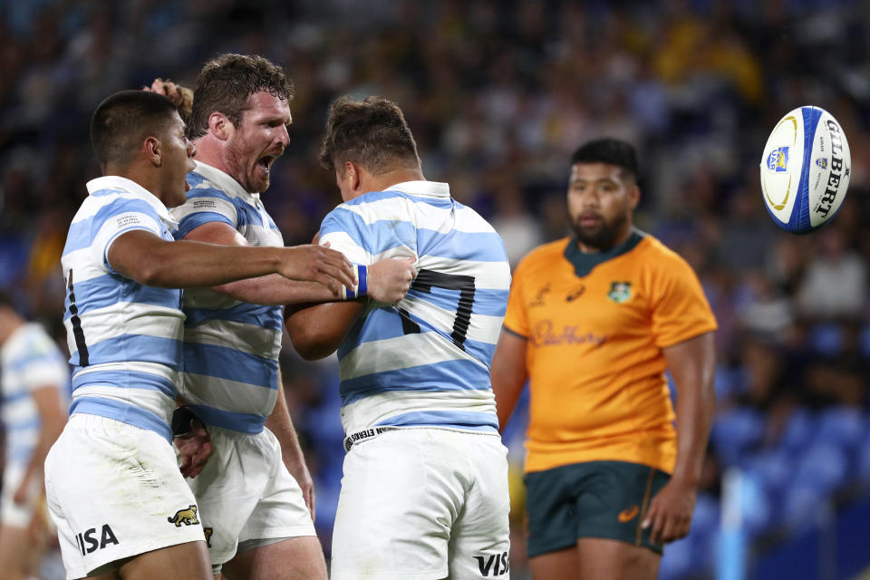 Argentina's Thomas Gallo, third left, celebrates with teammates after scoring a try against Australia during their Rugby Championship test match on the Gold Coast, Australia, Saturday, Oct. 2, 2021. (AP Photo/Tertius Pickard)