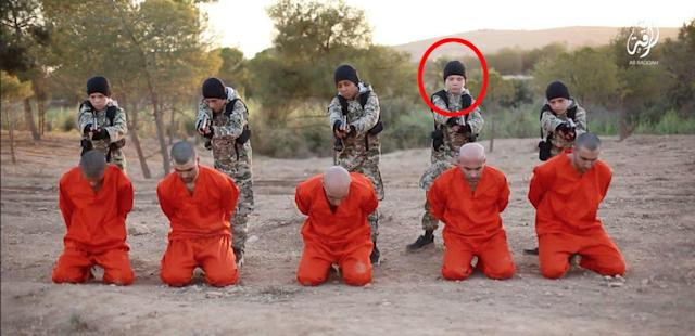 A boy believed to be Jojo Dixon, son of Sally-Anne Jones is seen (circled) in this Islamic State propaganda video before executing a Kurdish fighter.