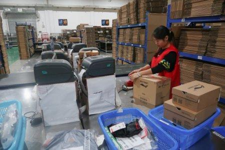 A BEST Inc employee scans parcels at one of the company's Shanghai order fulfillment centres in Shanghai, China November 8, 2017. Picture taken November 8, 2017. REUTERS/Brenda Goh