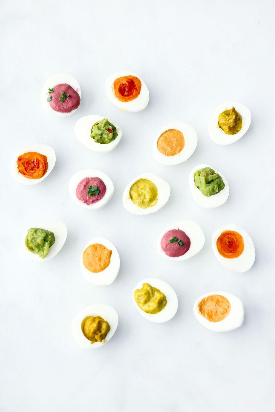 """<p>Of course, <a href=""""https://www.goodhousekeeping.com/food-recipes/easy/g606/deviled-eggs-recipes/"""" rel=""""nofollow noopener"""" target=""""_blank"""" data-ylk=""""slk:deviled eggs"""" class=""""link rapid-noclick-resp"""">deviled eggs</a> are a delightful appetizer. If you make a rainbow out of 'em, they're even better.</p><p><a href=""""https://www.goodhousekeeping.com/food-recipes/easy/videos/a37564/rainbow-colored-deviled-eggs/"""" rel=""""nofollow noopener"""" target=""""_blank"""" data-ylk=""""slk:Get the recipes for Rainbow Deviled Eggs »"""" class=""""link rapid-noclick-resp""""><em>Get the recipes for Rainbow Deviled Eggs »</em></a></p>"""