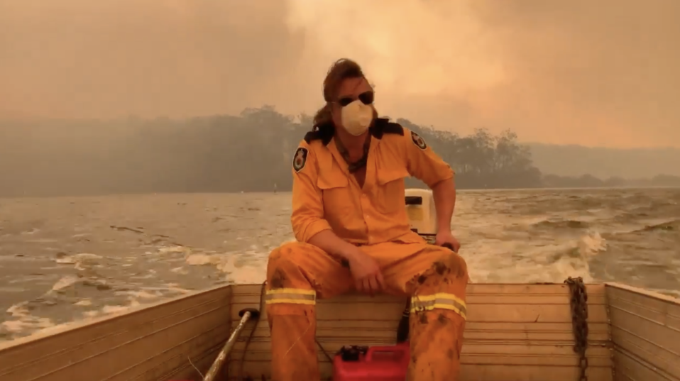 Ms Harvey and her friend Simon could only watch from the water as the bushland around their homes was destroyed. Source: Supplied.