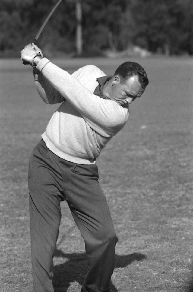 <p>Arnold Palmer during the backswing of a shot. (Photo by Rogers Photo Archive/Getty Images) </p>