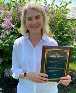 Dr. Mary Jane Ireland, CFIA, with her plaque