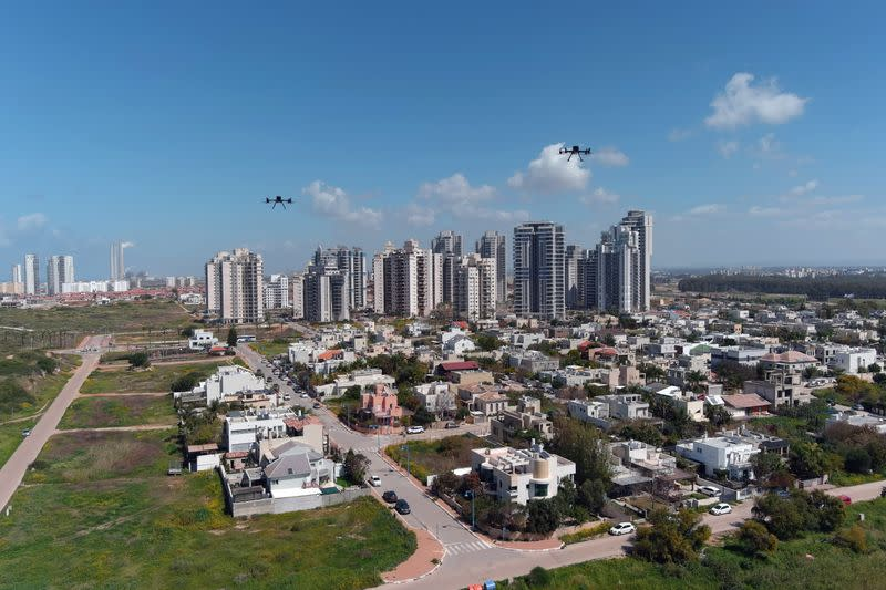 Delivery drones are seen midair during a demonstration whereby drones from various companies flew in a joint airspace and were managed by an autonomous control system in Haifa, as Hadera is seen in the background