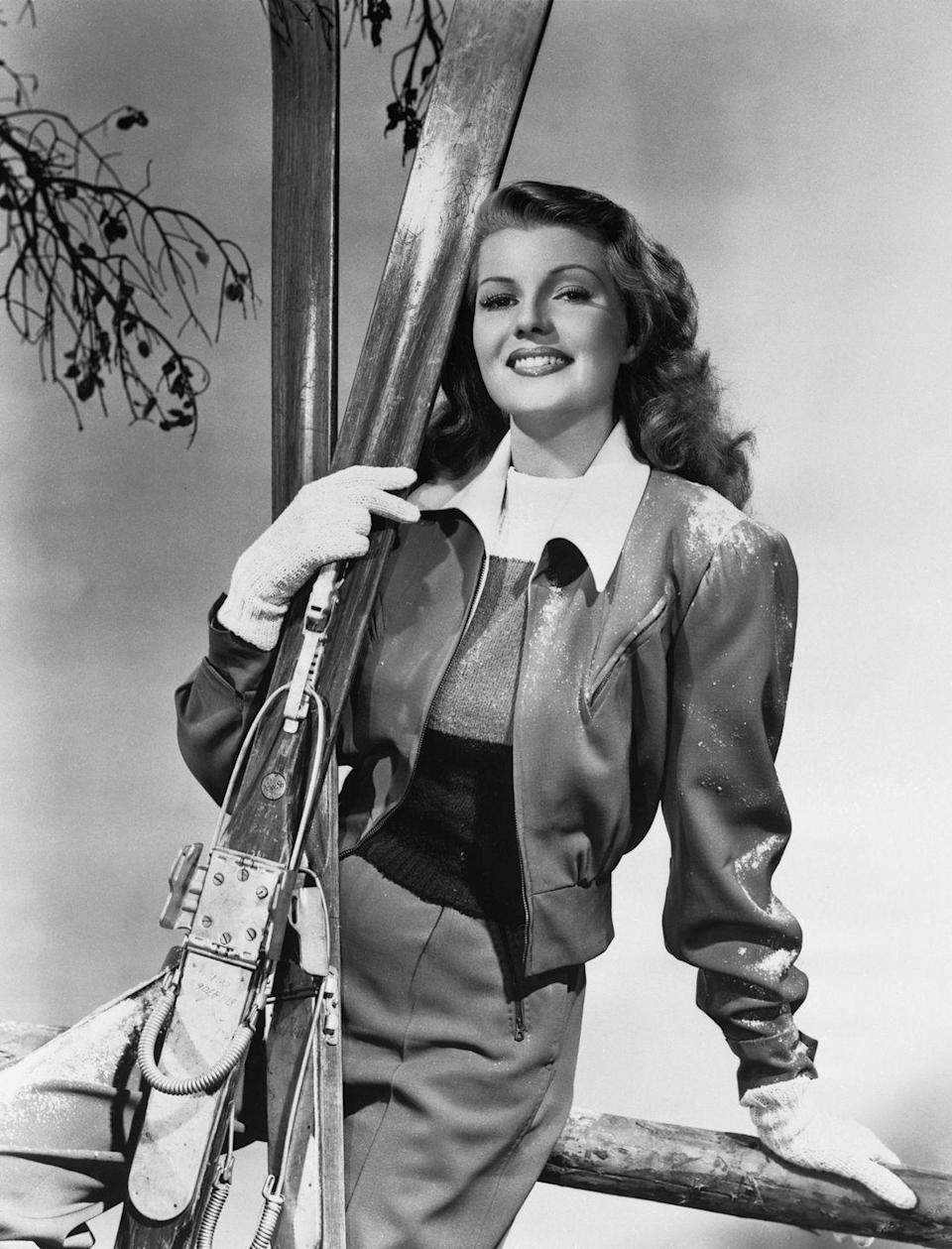 <p>Rita Hayworth looks ready for the slopes with her skis and gloves, circa 1940. </p>