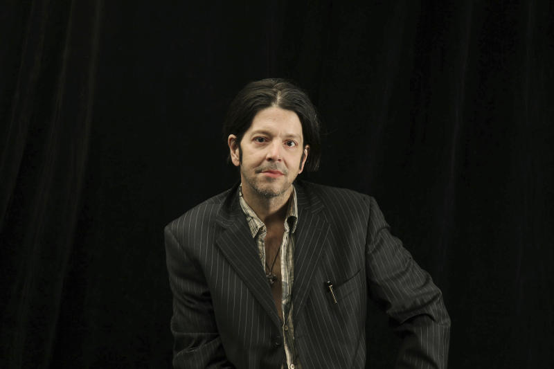 CORRECTS WHERE HE DIED - In this Oct. 6, 2009 photo, former Husker Du drummer Grant Hart poses for a photo in Minneapolis. Hart, 56, died late Wednesday, SEPT. 13, 2017, at a Minneapolis hospital from complications of liver cancer and hepatitis C, his wife, Brigid McGough, said in an email to Minnesota Public Radio's The Current. (Elizabeth Flores/Star Tribune via AP)