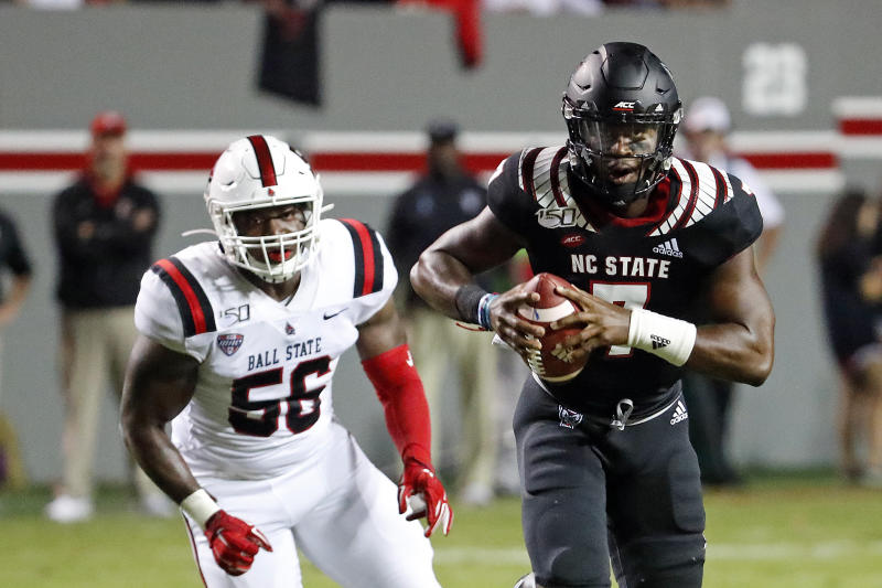 North Carolina State's Matthew McKay (7) scrambles away from Ball State's Shannon Hall (56) during the first half of an NCAA college football game in Raleigh, N.C., Saturday, Sept. 21, 2019. (AP Photo/Karl B DeBlaker)