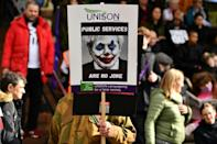 more than 2,000 protesters rallied against the Conservatives on the opening day of their conference (AFP/Ben STANSALL)