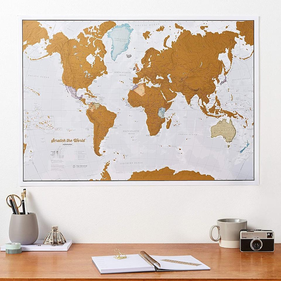"""It'llbe a pretty reminder of your past travels and how staying inside not spending money will make your future travels even more spectacular!<br /><br /><strong><a href=""""https://www.amazon.com/Maps-International-Scratch-World-Travel/dp/B00O8PNW6M?&linkCode=ll1&tag=huffpost-bfsyndication-20&linkId=f69b56f1cc3dd684a252b5f948c792ef&language=en_US&ref_=as_li_ss_tl"""" target=""""_blank"""" rel=""""noopener noreferrer"""">Get it from Amazon for $24.99.</a></strong>"""