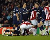 Stoke city's Glenn Whelan attends to Arsenal's Aaron Ramsey (L) after he suffers a serious leg injury in a challenge with Stoke's Ryan Shawcross (not pictured), in Stoke-on-Trent, in February 2010 (AFP Photo/Paul Ellis)