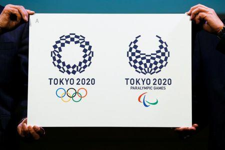 Tokyo 2020 Emblems Selection Committee Chairperson Miyata and committee member Oh present the winning design of the Tokyo 2020 Olympic Games and Paralympic Games in Tokyo