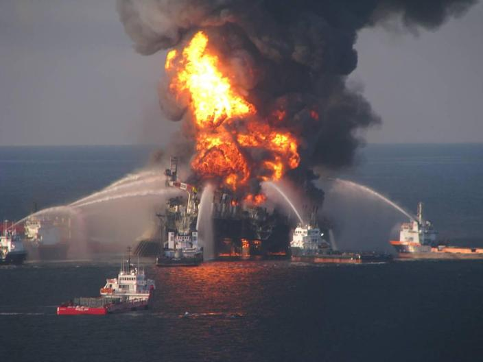 In this April 21, 2010, file image provided by the U.S. Coast Guard, fire boat response crews battle a massive fire on offshore oil rig Deepwater Horizon.