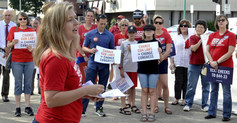 Tosha Pelfrey of Moms Demand Action speaks during a rally to protest gun violence n front of the United Building in Charleston, W.Va., Saturday, Aug. 17, 2019. (Chris Dorst/Charleston Gazette-Mail via AP)