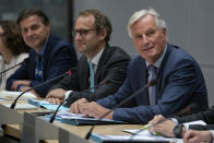 European Union chief Brexit negotiator Michel Barnier, right, sits along with his team during a meeting with Britain's Brexit Secretary Stephen Barclay at the European Commission headquarters in Brussels, Friday, Sept. 20, 2019. (Kenzo Tribouillard/Pool via AP)