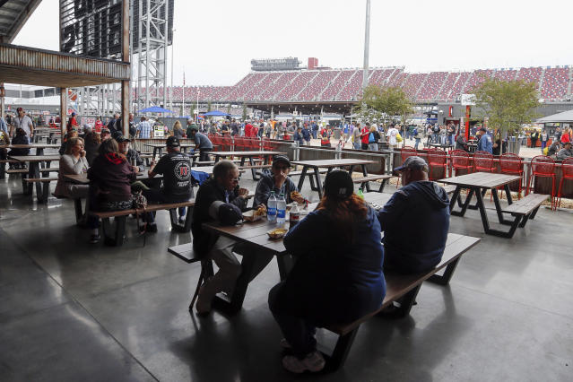 Fans eat at the new facilities before the 1000Bulbs.com 500 at Talladega Superspeedway, Sunday, Oct 13, 2019, in Talladega, Ala. (AP Photo/Butch Dill)