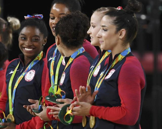 2016 Rio Olympics - Artistic Gymnastics - Final - Women's Team Final - Rio Olympic Arena - Rio de Janeiro, Brazil - 09/08/2016. Simone Biles (USA) of USA, Gabrielle Douglas (USA) of USA (Gabby Douglas), Laurie Hernandez (USA) of USA, Madison Kocian (USA) of USA, Alexandra Raisman (USA) of USA (Aly Raisman) on the podium after winning the women's team final. REUTERS/Dylan Martinez FOR EDITORIAL USE ONLY. NOT FOR SALE FOR MARKETING OR ADVERTISING CAMPAIGNS.
