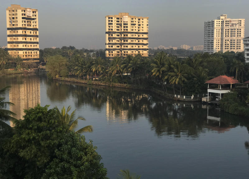 Water-front residential apartments Alpha Serene, left and center, and Holy Faith H2O, right, stand before they are scheduled to be razed to the ground by controlled implosion in Kochi, India, Saturday, Jan. 11. 2020. Authorities in southern Kerala state on Saturday razed down two high-rise luxury apartments using controlled implosion in one of the largest demolition drives in India involving residential complexes for violating environmental norms. (AP Photo/R S Iyer)