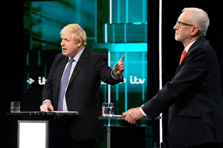 A handout picture taken and released by ITV shows Britain's Prime Minister Boris Johnson (L) and Britain's Labour Party leader Jeremy Corbyn (R) as they debate in Manchester (AFP Photo/Jonathan HORDLE)