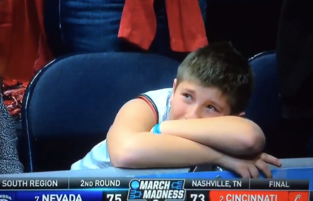 TNT cameras hung on a young Cincinnati fan for a full 12 seconds after Nevada's epic comeback. (Screenshot: TNT/Twitter)