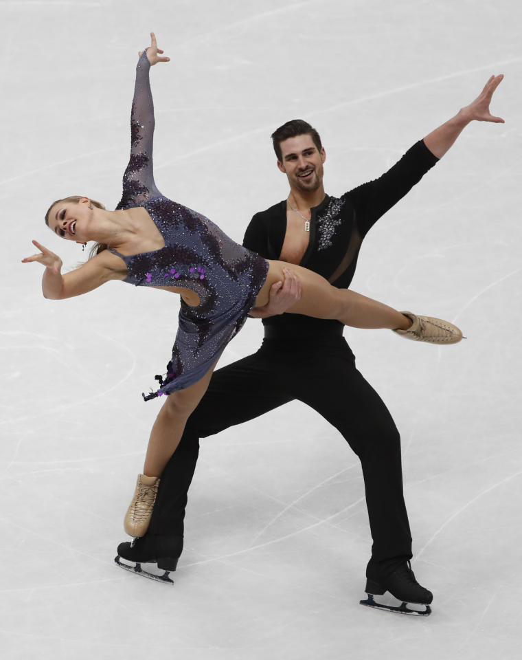 FILE - In this March 23, 2018, file photo, Madison Hubbell and Zachary Donohue perform during the pairs Ice dance short program at the Figure Skating World Championships in Assago, near Milan, Italy. For the season following an Olympics, Skate America certainly is packed with top U.S. competitors. The six-event Grand Prix series begins in Everett, Washington on Friday, Oct. 19. (AP Photo/Antonio Calanni, File)