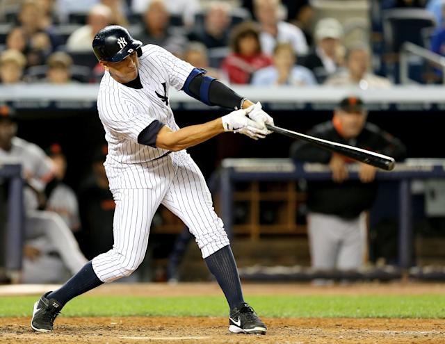 Alex Rodriguez of the New York Yankees hits a grand slam against the San Francisco Giants on September 20, 2013 at Yankee Stadium in the Bronx borough of New York City (AFP Photo/Elsa)