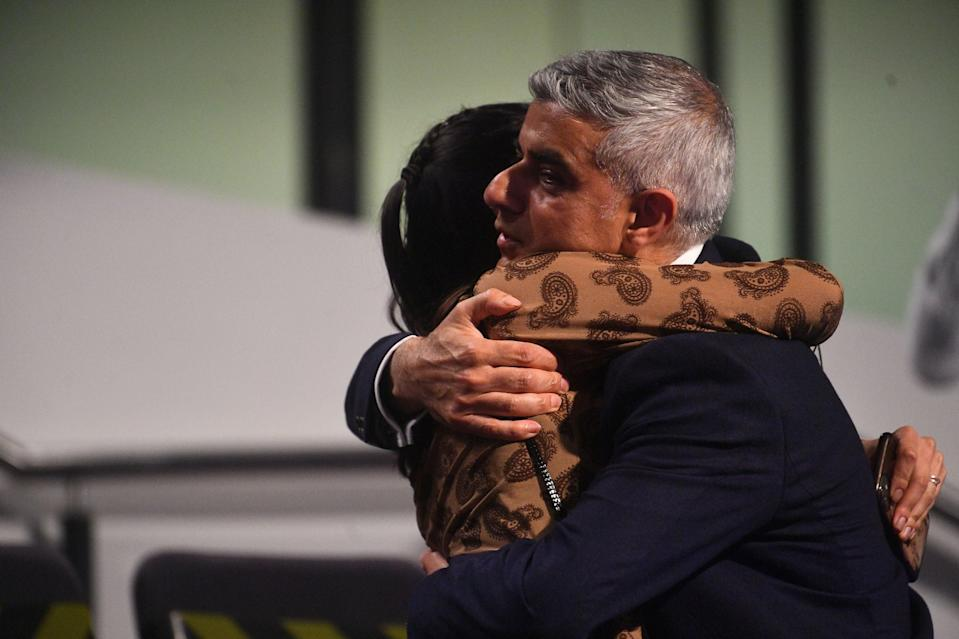 <p>Sadiq Khan is hugged by his daughter after winning a second term</p> (PA)