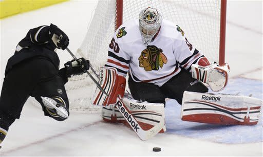 Chicago Blackhawks goalie Corey Crawford (50) blocks a shot by Dallas Stars center Derek Roy during the third period of an NHL hockey game on Saturday, March 16, 2013, in Dallas. The Blackhawks won 8-1. (AP Photo/LM Otero)