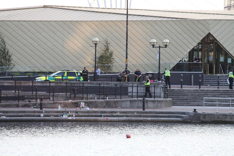 Ploce at the scene where a19-year-old man's body was pulled from a canal at Salford Quays, Greater Mancs., yesterday around three hours after he got into difficulty at around 4.40pm yesterday (July 18) See SWNS story SWLEwater;