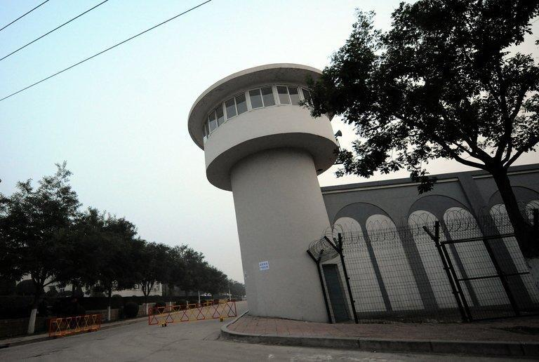 """A watch tower seen from the road leading to the prison where dissident Liu Xiaobo was incarcerated, on October 9, 2010. A friend of the jailed Nobel Peace Prize laureate, Liao Yiwu is a keen critic of China's rulers and elite, whom he has accused of accumulating """"dirty wealth"""""""