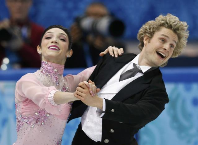 Meryl Davis (L) and Charlie White of the U.S. compete during the figure skating team ice dance short dance at the Sochi 2014 Winter Olympics, February 8, 2014. REUTERS/Alexander Demianchuk (RUSSIA - Tags: SPORT FIGURE SKATING OLYMPICS)