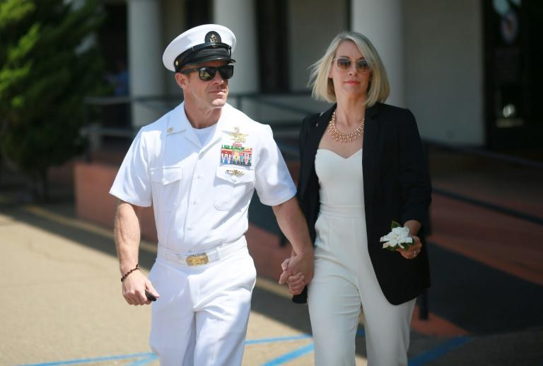 Navy Special Operations Chief Edward Gallagher walks out of military court with his wife Andrea as the jury deliberates in his war crimes trial, on July 2, 2019 in San Diego, California