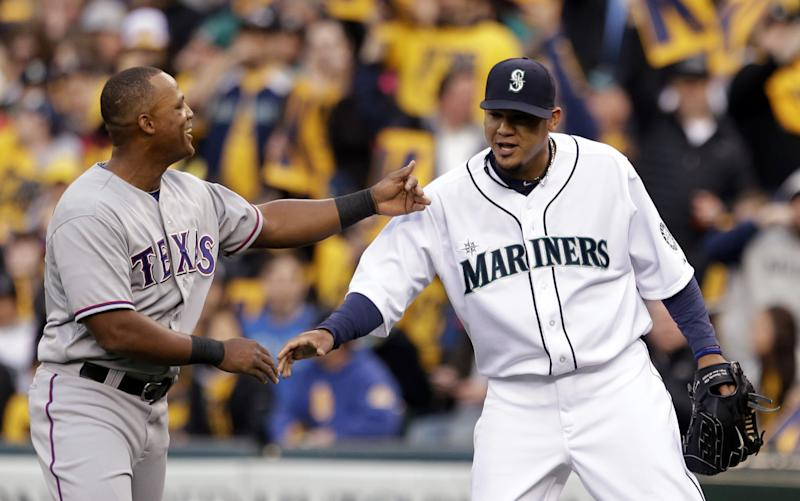 Texas Rangers' Adrian Beltre, left, congratulates Seattle Mariners starting pitcher Felix Hernandez on Hernandez's 1,500th career strikeout in the first inning of a baseball game on Thursday, April 11, 2013, in Seattle.