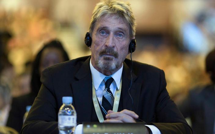 Founder of the first commercial anti-virus program that bore his name, John McAfee listens during the 4th China Internet Security Conference (ISC) in Beijing - AP