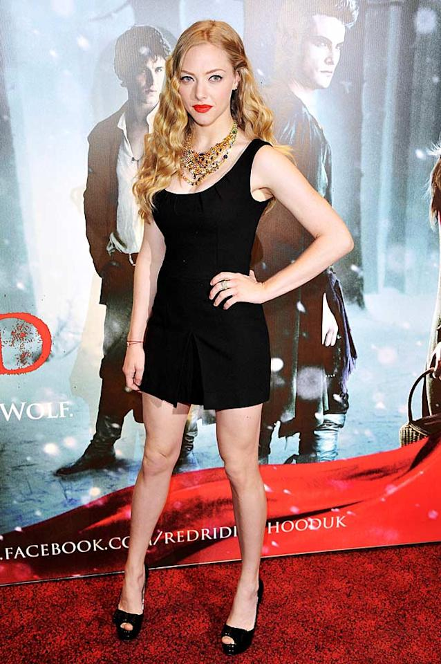"""Despite being in London for the European premiere of """"Red Riding Hood,"""" Amanda Seyfried oozed Old Hollywood glamour thanks to her Karen Caldwell LBD, matching patent leather peep-toes, bright red lips, and Tom Binns statement necklace. Jon Furniss/<a href=""""http://www.wireimage.com"""" target=""""new"""">WireImage.com</a> - April 7, 2011"""