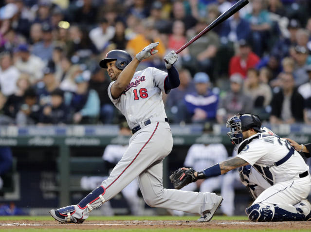 FILE - In this May 18, 2019, file photo, Minnesota Twins' Jonathan Schoop follows through with a three-run home run off Seattle Mariners' Parker Markel during the third inning of a baseball game in Seattle. The Detroit Tigers agreed to one-year deals with free agents Jonathan Schoop and C.J. Cron, adding some power to a team that finished last in the American League in home runs in 2019. (AP Photo/John Froschauer, File)