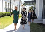 For the second day of Japanese Prime Minister Shinzo Abe and his wife Akie Abe's visit to the White House visit, Melania Trump dressed in a forest green shirt dress in Palm Beach. [Photo: Getty]